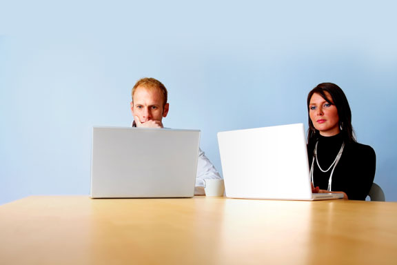 Two People at Laptops
